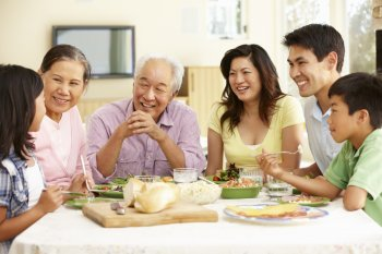 Multi-generational Asian family sharing a meal